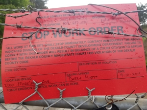 DeKalb County slapped a stop work order on a site owned by Crown Enterprises